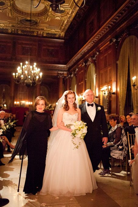 Brides.com: Our Favorite Mother-of-the-Bride Dresses from Real Weddings. Sarah and Scott held a timeless fall wedding at the opulent University Club in New York City. Sarah's mother's formal black dress received dramatic flair from the accompanying sheer shawl.  See more black mother-of-the-bride dresses.  View more photos from Sarah and Scott's wedding.