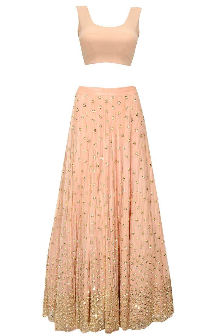 Peach shimmer lehenga set by Astha Narang. Shop now: http://www.perniaspopupshop.com/designers/astha-narang #lehenga #asthanarang #shopnow #perniaspopupshop