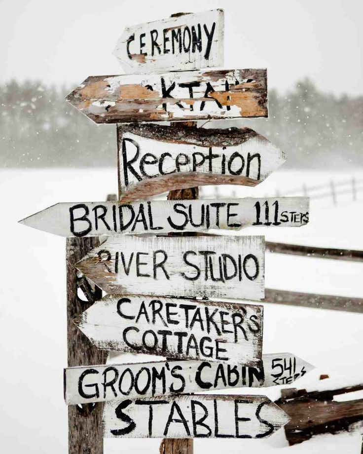 Creative Wedding Signs | Martha Stewart Weddings - Hand-painted signs directed guests around the grounds of this snowy Vermont wedding venue.