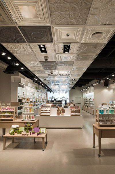 The different shades of grey used on the detailed ceiling create a flow throughout the whole store drawing the eye to look at all the merchandise displays.