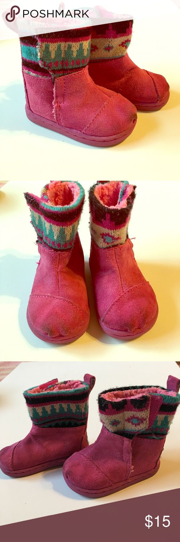 Tiny Toms Nepal Boots - pink suede - size 4 Tiny Toms Nepal Pink Suede Boots in size 4 toddler. Velcro closure and faux fur lining. Some marks on tip of toes (see pictures). Super adorable for your little girl! TOMS Shoes Boots
