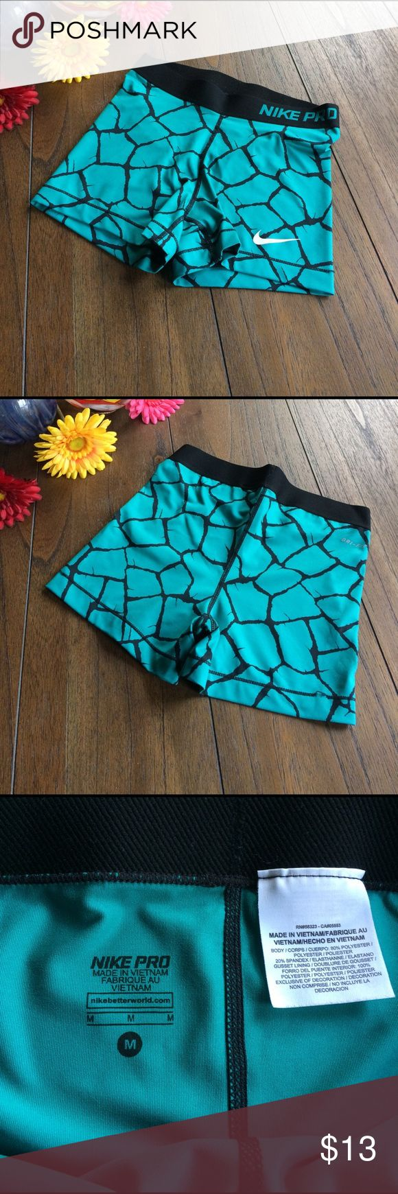 Nike Pro Compression Shorts EUC Nike Pro compression shorts with Dri-Fit technology. Aqua/Green with black pattern. Girl size Medium. Fits approximately 10-12 y/o. Nike Bottoms Shorts