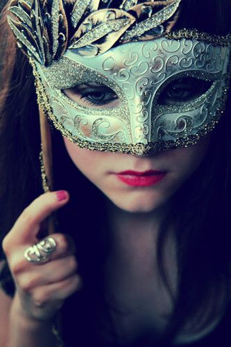 Blue eyes behind a mask....By the way, what a wonderful teal/golden mask that is!!!!