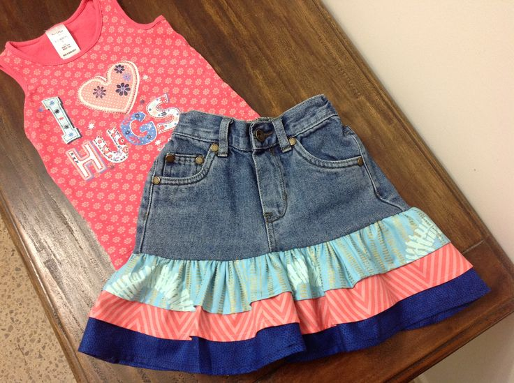 This skirt was retr need from a pair of three quarter jeans.  The legs obviously were cut off and three frills added.  The fabric for the frills was chosen so that it would match the little singlet top.