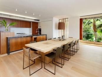 Casual dining room idea with floorboards & floor-to-ceiling windows - Dining Room Photo 1187444