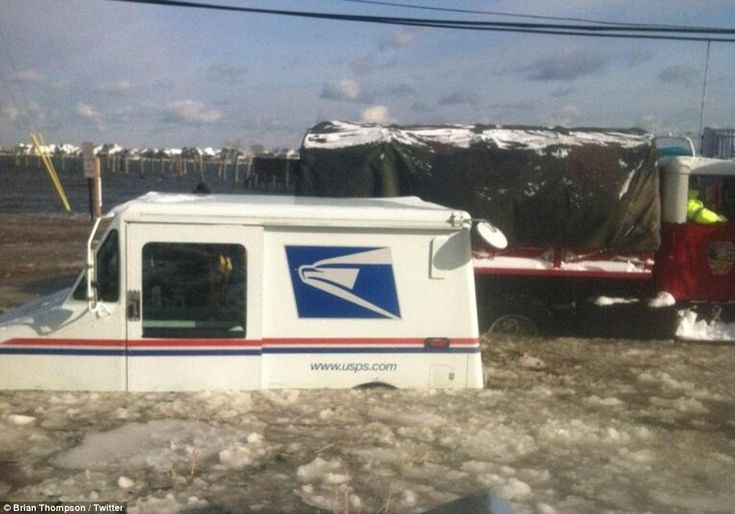 There's a problem with your parcel... A UPS truck becomes stuck at Monmouth Beach, New Jersey during icy waters at high tide. The mailman wa...