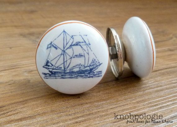 This listing is for 2 blue and white nautical ship knobs. It is bordered with a caramel/tan brown thin line and accented with a silver base. So intricate, this ship knob is perfect for beach house decor, pirate/ocean/nautical nursery decor, or anyone with a general love of the sea.  DIY, design your own jewelry holder, up-cycle some shabby kitchen cabinets or an old dresser. It is made from ceramic, has a light/medium weight and will extend from your drawer/cabinet 1. The diameter is 1 1/2…