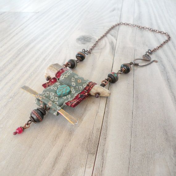 Nomadic Scroll Necklace Silk Wrapped Antler by GypsyIntent on Etsy. Idea for incorporating fabric into jewelry