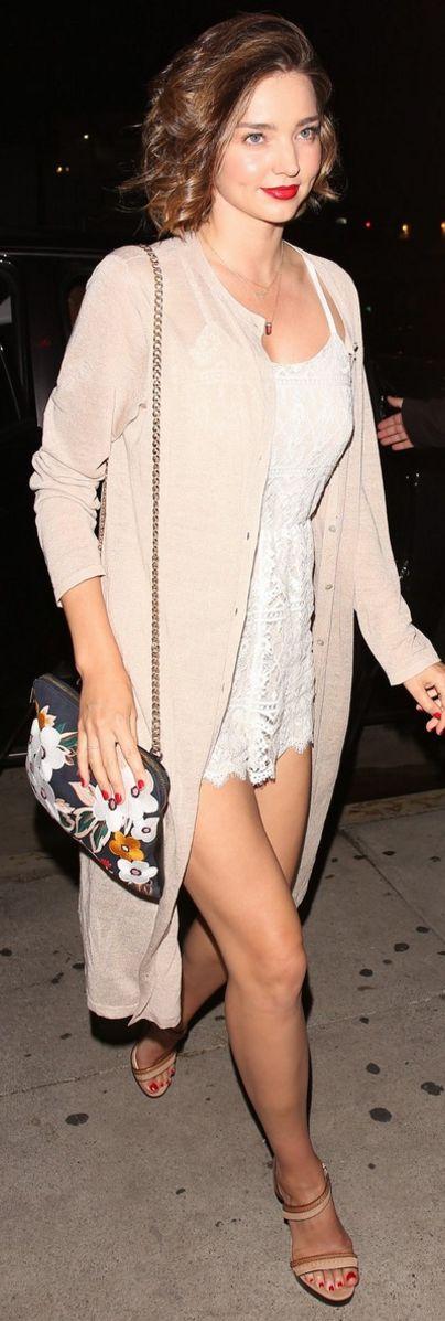 Miranda Kerr: Romper – Alice + Olivia  Bracelet – Swaroski  Shoes – Christian Louboutin  Sweater – Eileen Fisher
