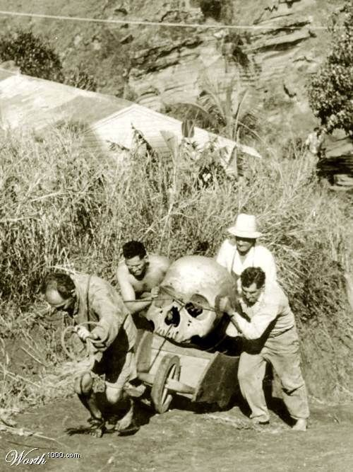 This giant skeleton was found in Pitcairn Island, New Zealand in1934. Local farmers are trying to hide pieces of a giant skeleton found near 'Christians cave'. Three of the men were later found dead under strange circumstances. The forth man disappeared soon after this photo was taken and was never found. The photographers identity has never been revealed.