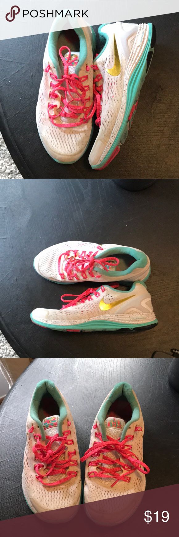 NIKE LUNARGLIDE + 4 CHICAGO MARATHON These limited edition lunar glides are truly one of a kind. Made specifically for the Chicago marathon, these shoes are fun. Starting with the fun color scheme, the funfetti teals, golds and pinks go nicely with the white. Two icons cover the tongues of these shoes. While these shoes aren't in pristine condition they are still perfect for kicking it or bopping about town. Nike Shoes Sneakers