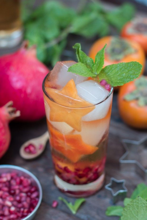 Upgrade your Thanksgiving with this festive sangria made with fresh fuyu persimmons and pomegranate. This cocktail is crispy, spicy, and ready to par-tay!
