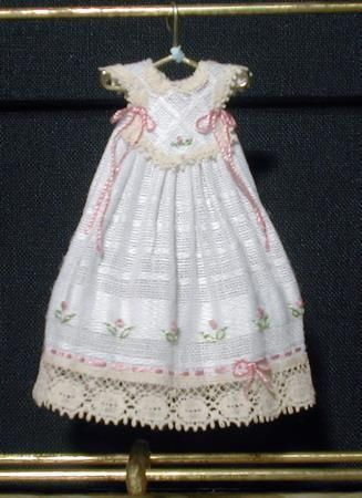 handcrafted tiny dress on hanger
