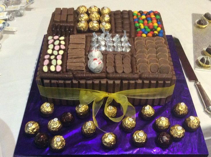 Chocolate cake Box, clinkers, flakes, Cadbury chocolate, Tim tams, mars bar pods, kisses, Ferraro Rocher, crispy m & m's, chocolate bullets, fantales, Raffaello, kit Kats and chocolate fingers.