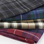 Tartan fabrics woven in Scotland. Tartan fabrics for every use from upholstery to home furnishings, clothing to table decoration.  There is nothing quite like the timeless design of the tartan check and we have wool tartan fabric, machine washable tartan fabrics and cotton tartan fabrics available in hundreds of Scottish clan tartans. Read our Tartan Fabric Guide for help in choosing the right tartan fabric for you. Seen is Pride of Scotland Wool Tartan Fabric