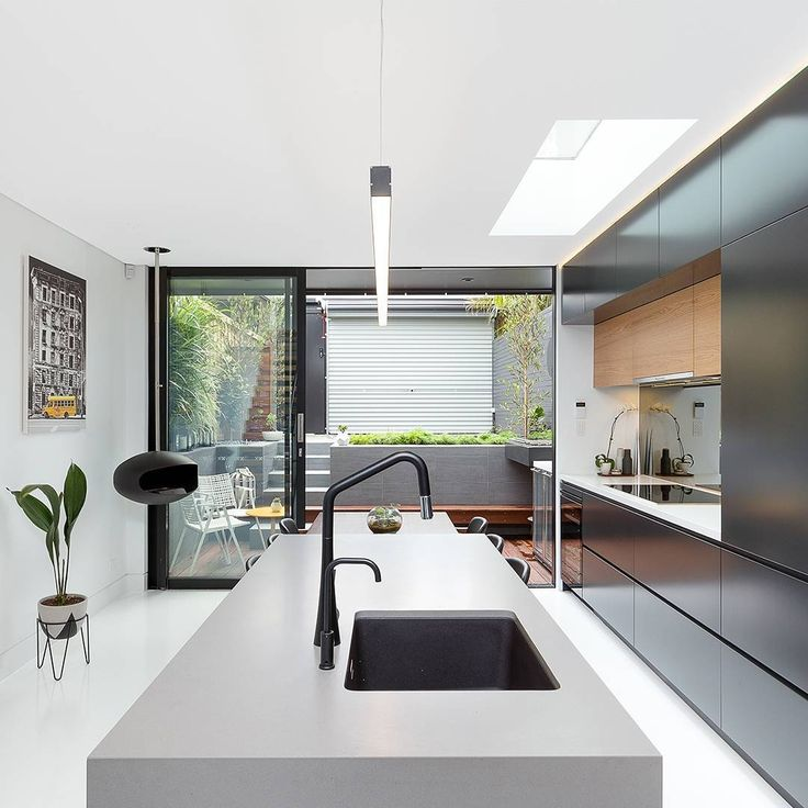 """Caesarstone double feature by @saltinteriors! Sleek Concrete & Pure White counters were both used in this #chic #modern kitchen. The combination of colors…"""