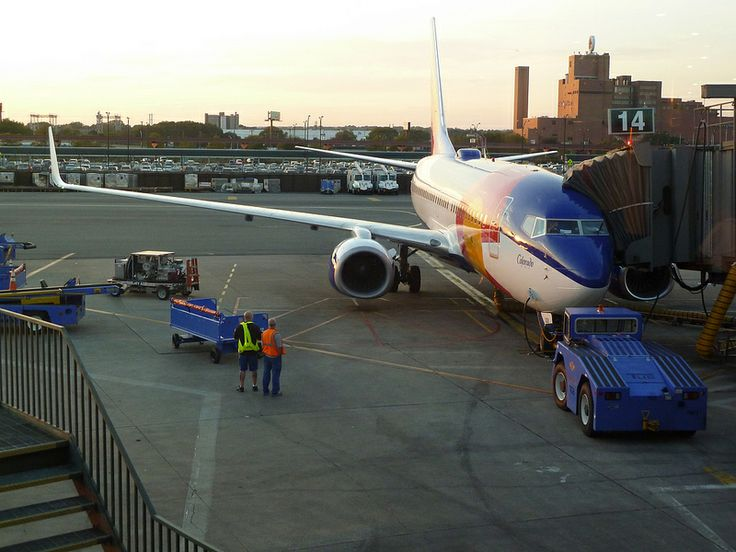 Southwest Airlines EWR airport crew prepare the new 'Colorado One' special livery Boeing 737-7H4WL jet N230WN for take-off from Newark, NJ