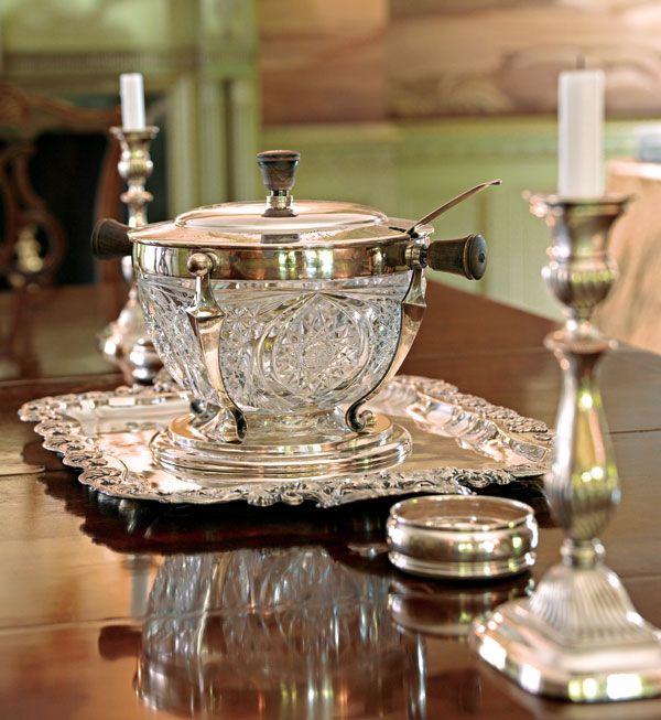 Classic antique silver and cut crystal has a timeless presence in any dining room - Traditional Home®