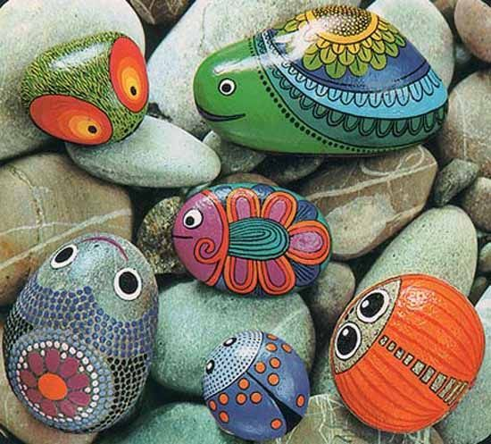 Painted rocks give unique accents to creative garden designs
