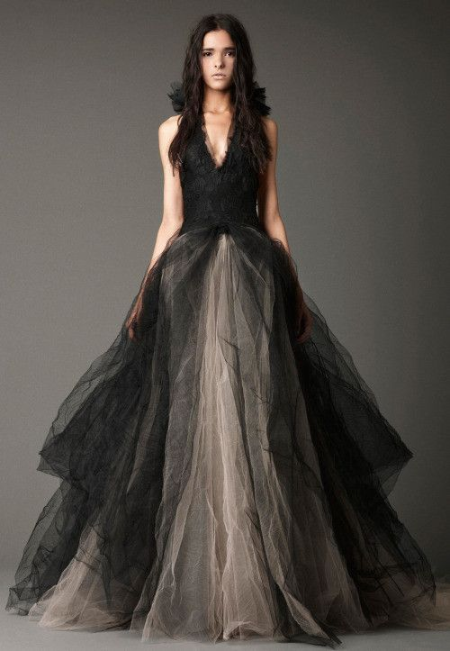 Certainly and edgy, unique wedding dress. The halter neckline and fitted bodice defines your waist. The skirt is complete with a great contrast of the black and nude tulle fabric.
