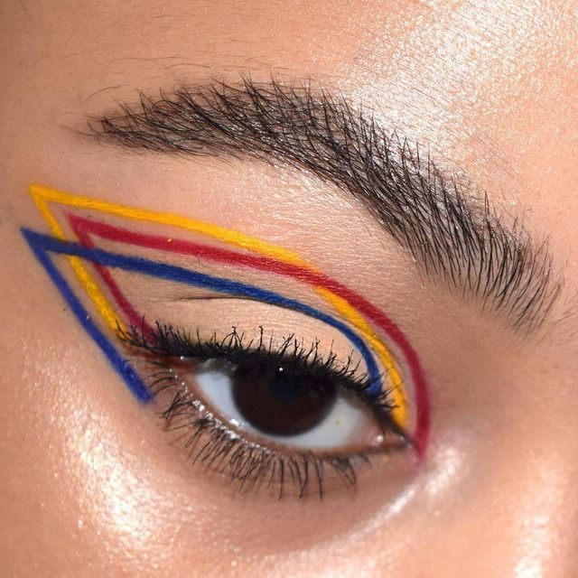 Primary colors: red, blue and yellow winged liner. Arty makeup.