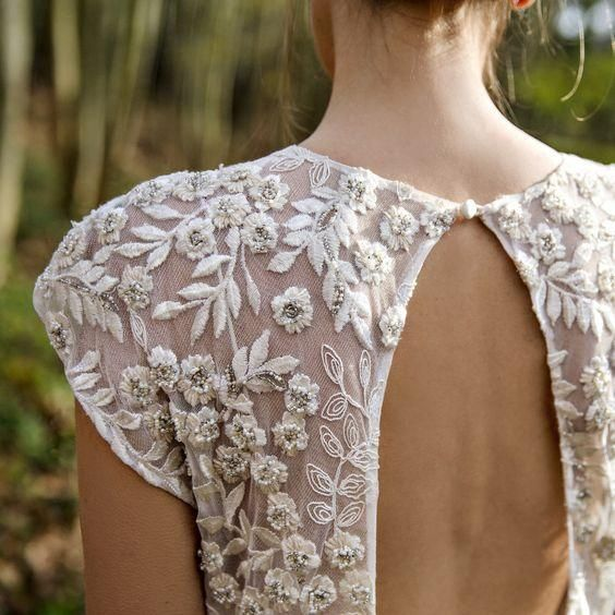 Beautiful detail laced back vintage wedding dress in vintage style