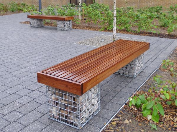Elements 1.8m bench with small slats and timber fascias. Gabions filled with Scottish beach cobbles.