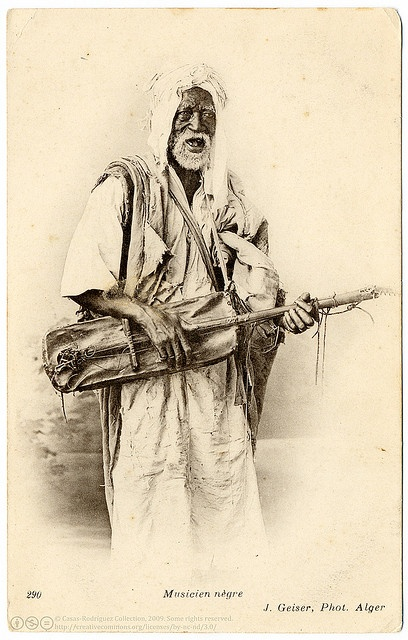 The Old Gnawi Musician (c.1906) by postaletrice, via Flickr. published by Jean Geiser, Algiers, Algeria.