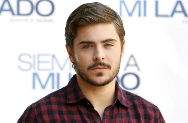 Zac Efron- beard and a plaid shirt, he's growing into a lumberjack!