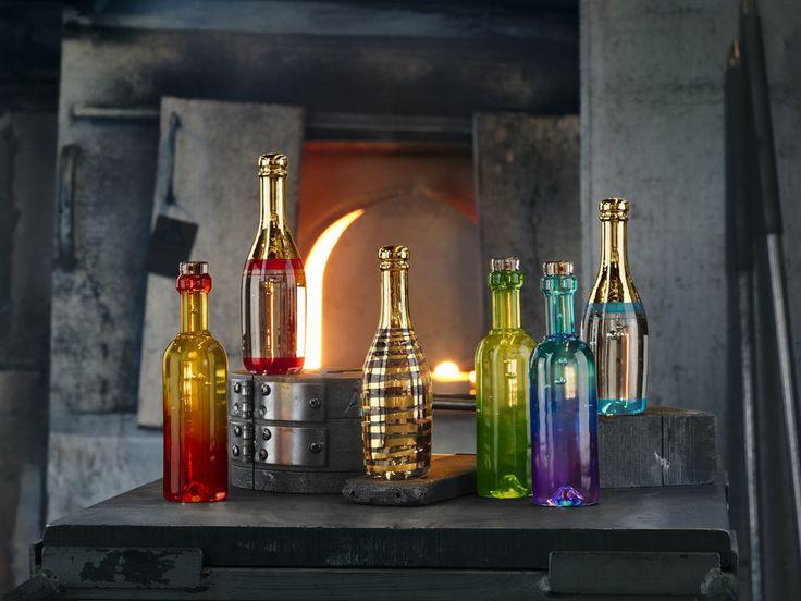 Celebrate bottles by Kjell Engman for Kosta Boda shot in the hot shop in Kosta