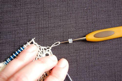 Use Crochet hook to transfer bead to knit stitch