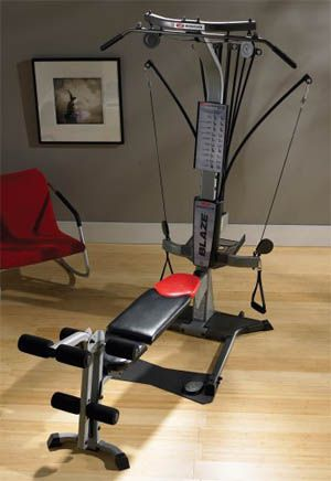 Man exercising his legs on the Bowflex Blaze home gym
