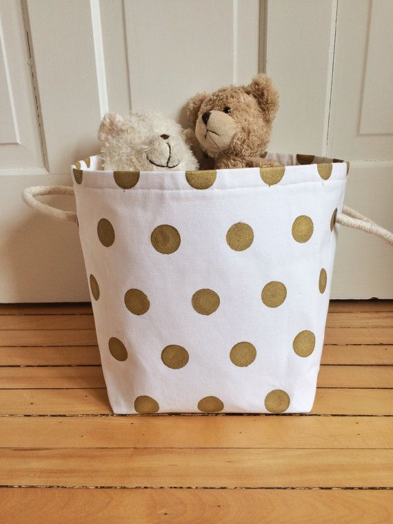 This super cute custom gold dot canvas bin is perfect for storing toys, books, etc... It is made out of reinforced canvas custom printed with gold