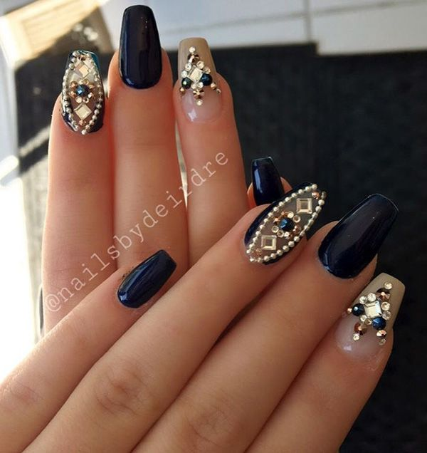 A beautiful combination of dark blue and beige with rhinestones that enrich the whole combination. Your just have to make decision about the length of the nail and shape that best stands to you.