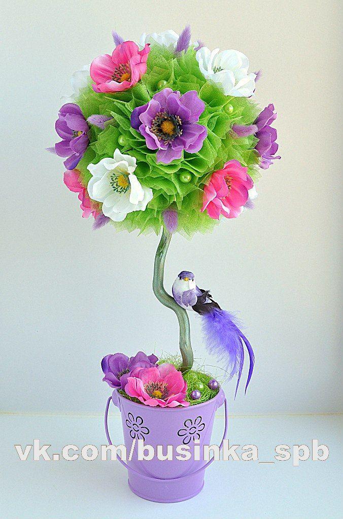 No todas las flores juntas sino separadas por follaje verde