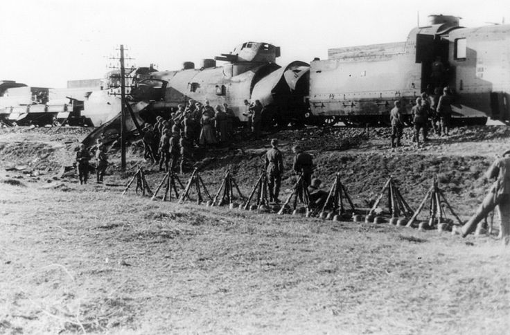 A damaged Polish armored train carrying tanks captured by the 14th SS-Leibstandard Adolf Hitler Division, near Blonie, during the invasion of Poland in September of 1939. (LOC/Klaus Weill)