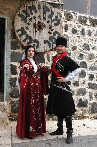 Lower Galilee, Circassian couple in traditional clothing at Kfar Kama