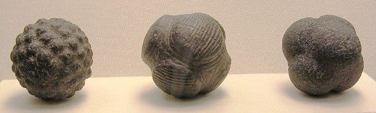 Three stone carved balls; Later Neolithic 3000 – 2000 BC, found at Novar, Ross-shire, and Old Deer, Aberdeenshire, Scotland. Over 400 of these stone carved balls have been discovered at sites mainly in the north and east of Scotland.