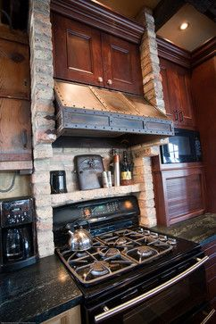 Modern country cottage storybook lake house kitchen stove design is by Degnan Design.