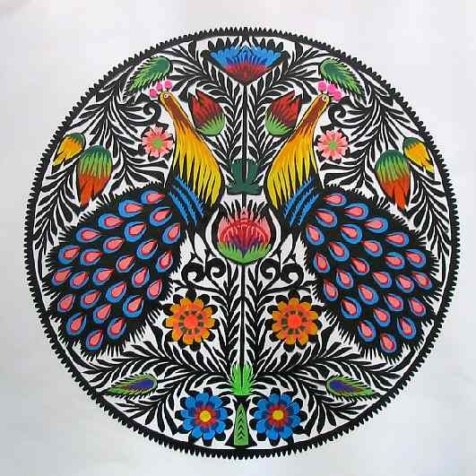 """Polish Cut Paper Art:  """"The multicolor Lowicz Wycinanki developed in a prosperous region west of Warsaw.  These elegant, elaborately cut and arranged overlays were displayed tandem style over the windows and doorways and on the walls of rural homes.""""  Animalarium: October 2010"""