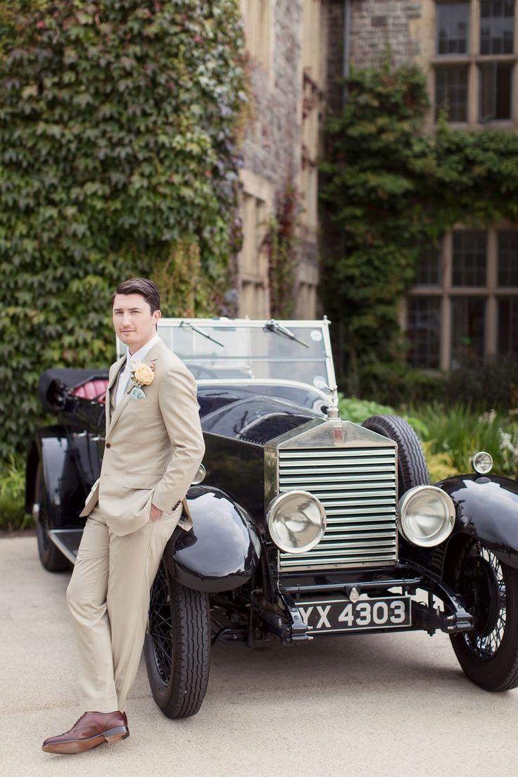 Groom with wedding vehicle