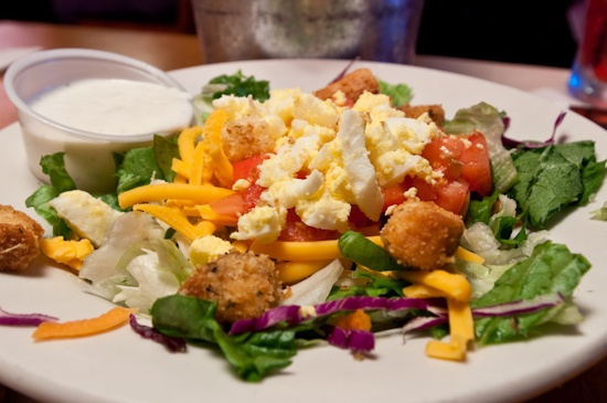 Fresh greens, cheddar cheese, tomato, eggs, and made-from-scratch croutons. Texas Roadhouse salad