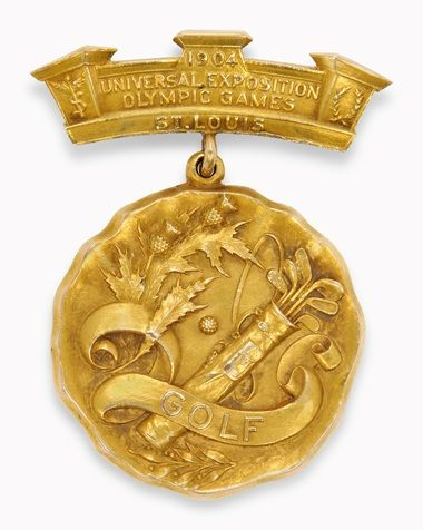 "Robert E. Hunter (1886-1971), American amateur golfer. Olympic gold - golf medal, c.1904, awarded to Robert E. Hunter, at the St. Louis Olympic Games. Made of 14k gold, cast in relief with a golf-bag, and thistles. The banner reads: ""Golf - 1904 Universal Exposition Olympic Games St. Louis"". ~ {cwl} ~ (Christie's Auction)"