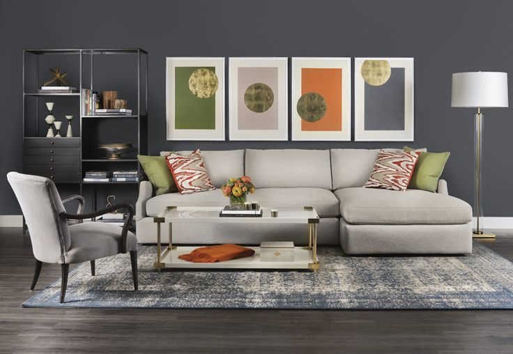 Uptown funk combining a dark neutral backdrop with for Grey and orange living room ideas