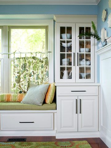 Built-ins beside a window create the perfect place for a relaxing window-seat . . . great storage too.