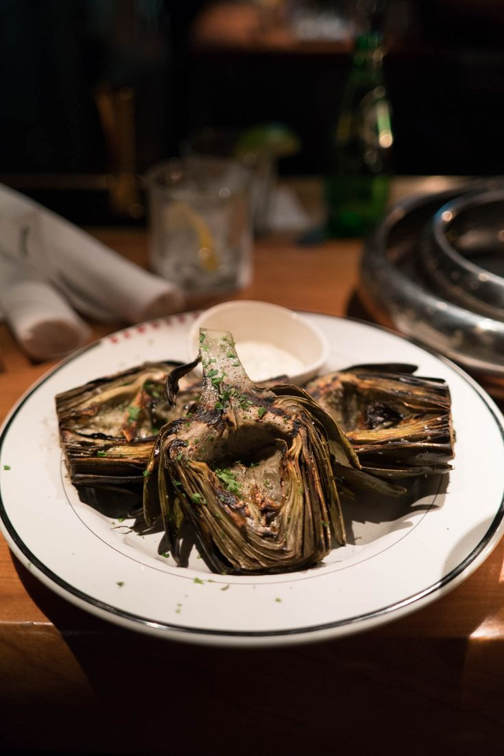 Try the artichokes at bandera restaurant on the magnificent mile in Chicago. Get more tips on where to eat and what to do in Chicago over on thetastesf.com #travel #chicago