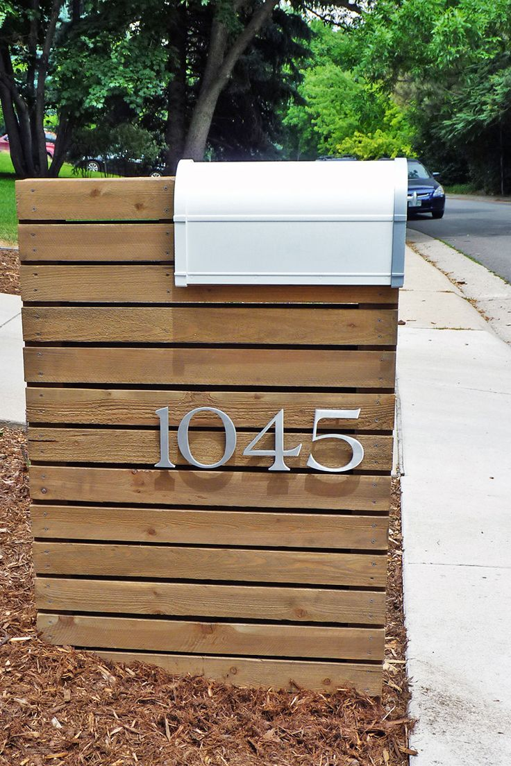 {delighted by this customer photo}  wow!  we love how cindy customized her mailbox. her brushed aluminum house numbers in our santa barbara typeface look both classic and modern installed on the exposed wood planks.  thanks for the photo cindy!  we like your style!  #yourMHN #modernhousenumbers #curbappeal