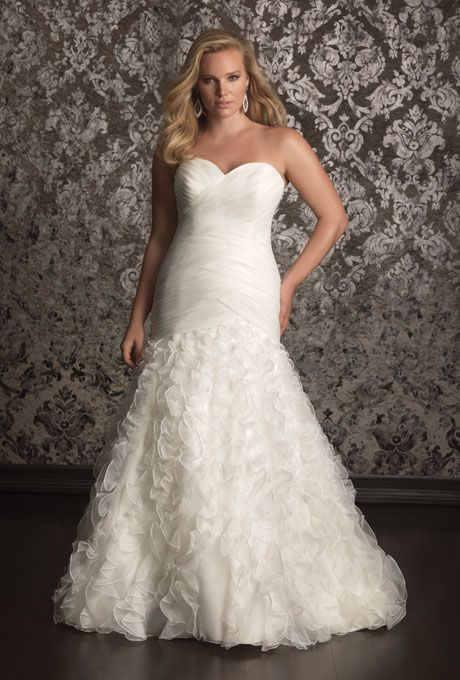 Brides.com: Designer Plus-Size Wedding Dresses We Love Style 3111, embroidery on beaded lace with a corset back, $1,058, Mori Lee  See more Mori Lee wedding dresses.Photo: Courtesy of Mori Lee