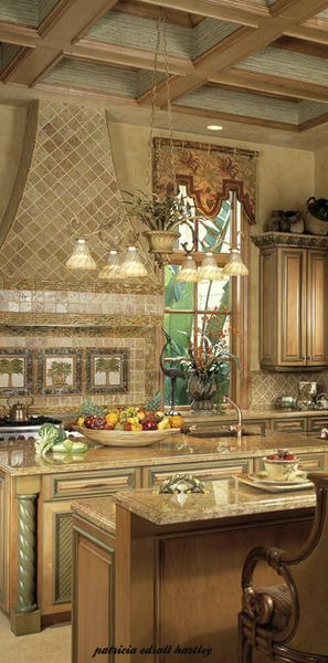 Mediterranean style kitchen with tiled hood