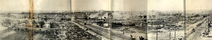 Taken from the southeast corner of the roof of Booker T. Washington High School, this panorama shows much of the damage within a day or so of the riot and fires. The road running laterally through the center of the image is Greenwood Avenue; the road slanting from the center to the left is Easton; and the road slanting off to the right is Frankfort.